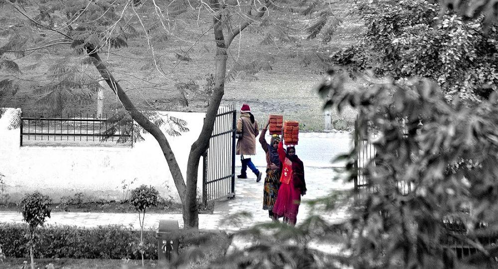 Photo in Random #india #woman #women #girl #women at work #red