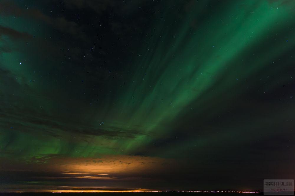 Photo in Landscape #aurora #borealis #northern #lights #reykjavik #iceland #landscape #show #cloud #light #pollution #night #distance #star #black #green #dance