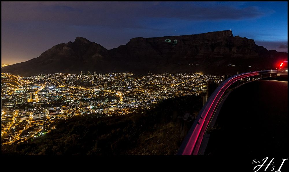 Table Mountain @ night with laser show in honour of late Nelson Mandela by HelenaSousa