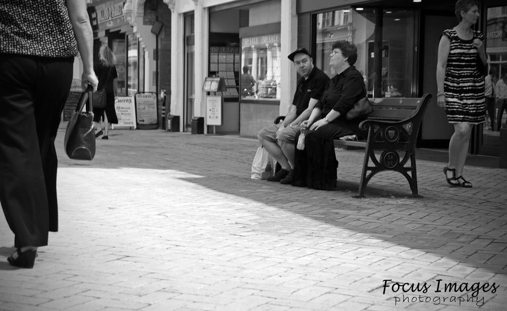 couple sitting on bench by grahambrown18