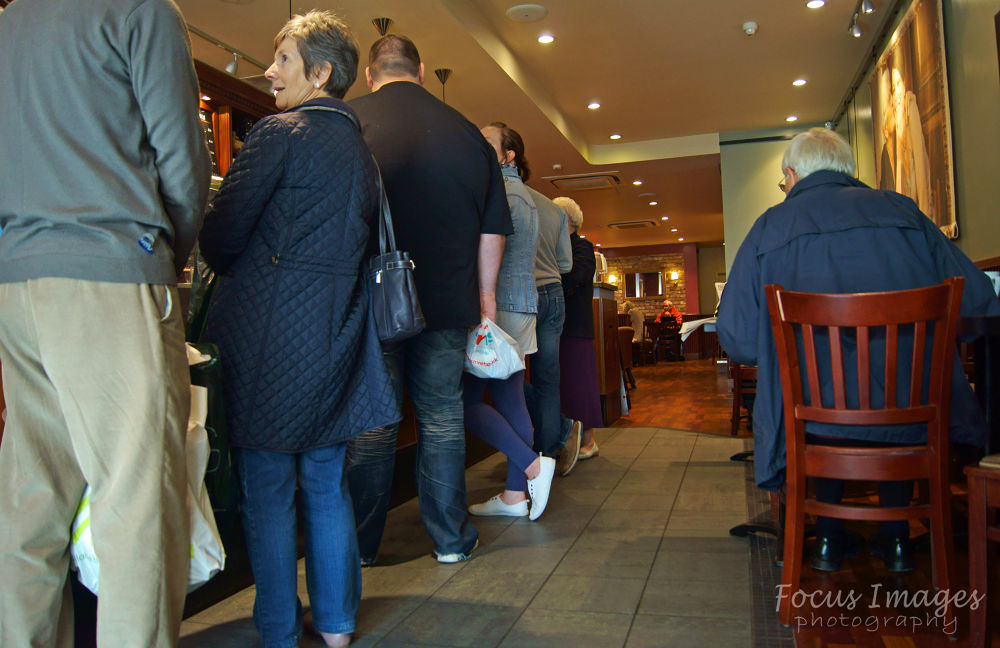 standing waiting to order  by grahambrown18