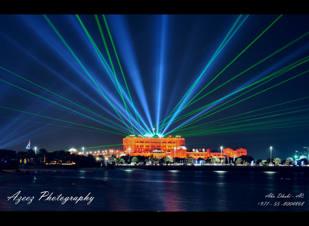 Powerful lasers adorned the Emirates Palace Hotel during National Day Celebrations. by azeezphotography