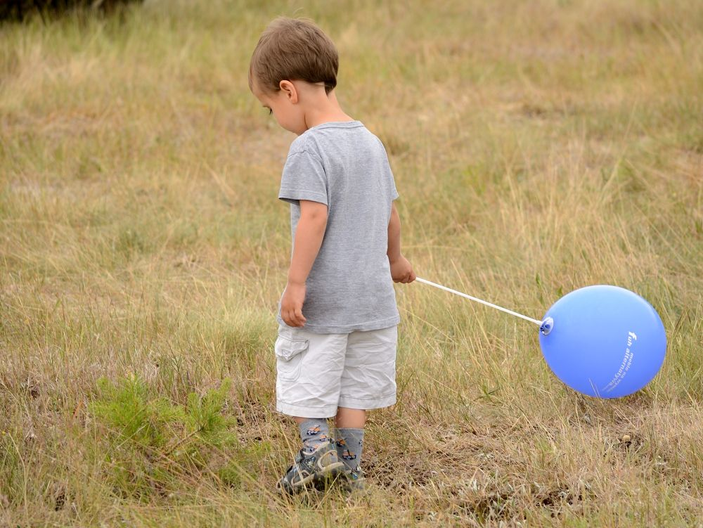 The boy with a toy-balloon by habibi27