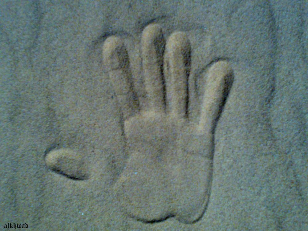 hand on sands by alkhwad