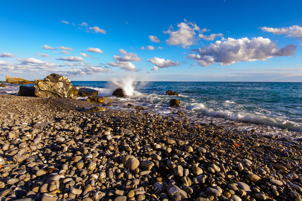 Photo in Landscape #shore #coast #wave #italy #mediterranian #stone #water #ocean #blue #sky