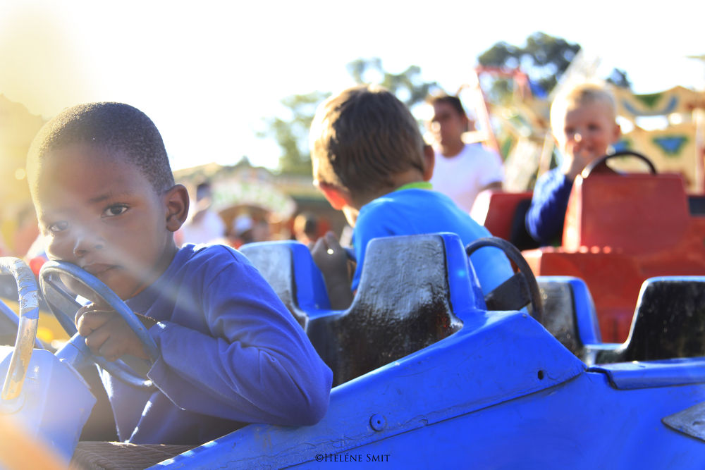 child on ride at festival.jpg by helenesmit88