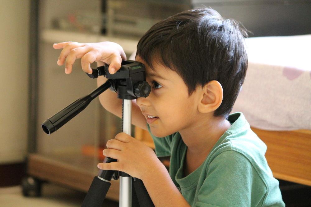 My nephew playing with my tripod.. by harshitvarma