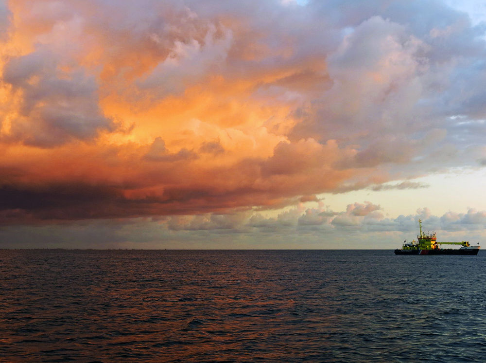 Photo in Nature #waddenzee #ameland #boat #sea #clouds #sunset #holland #netherlands