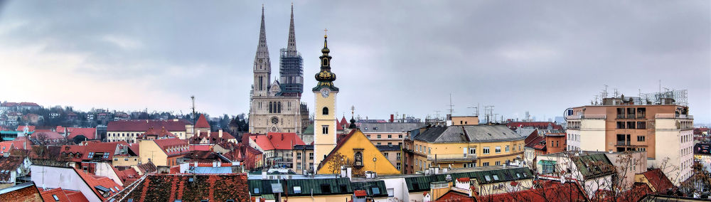 Panorama of roofs and towers by oliversvob