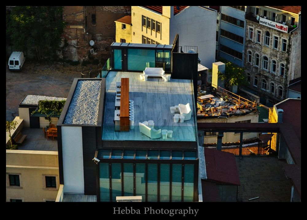 Sitting on the roof by HebbaPhotography