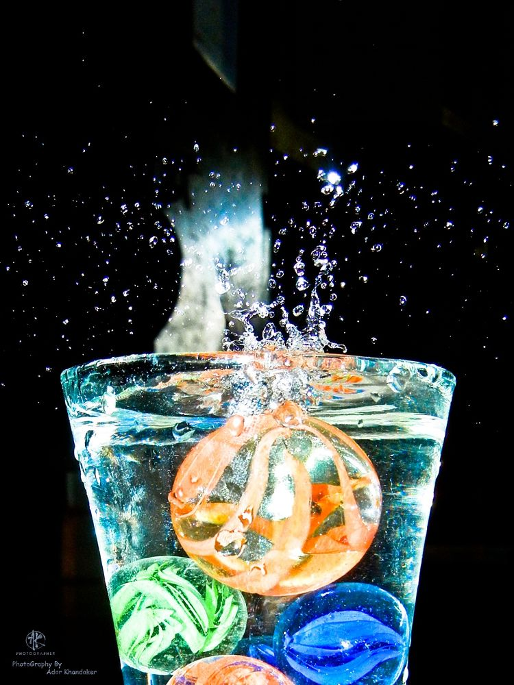 Ball fall into Water & water Fall down into outside in the glass by Khandaker Almas Mahmud Ador