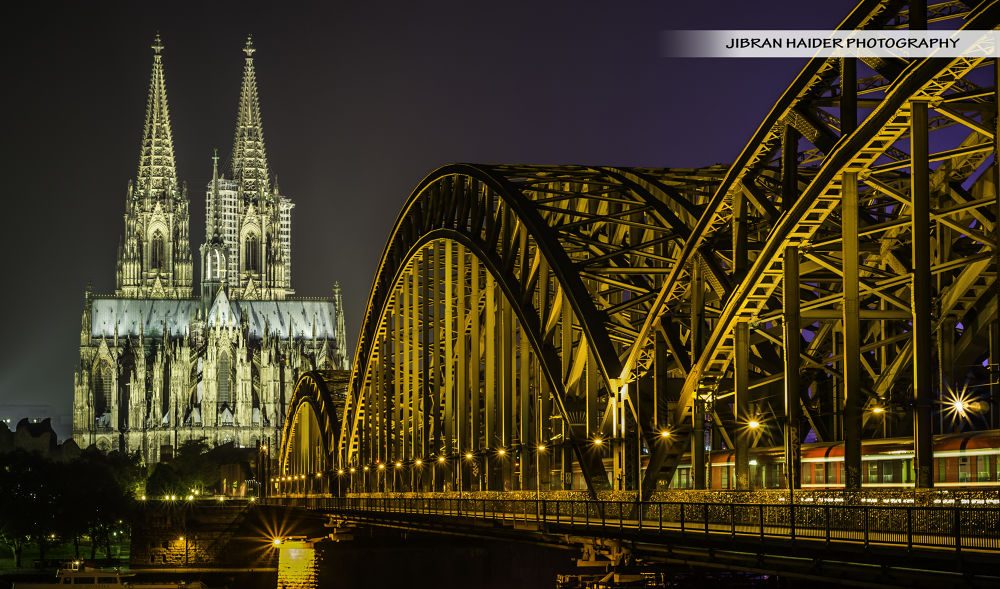 Cologne Cathedral and Hohenzollern Bridge  by Jibran_Haider