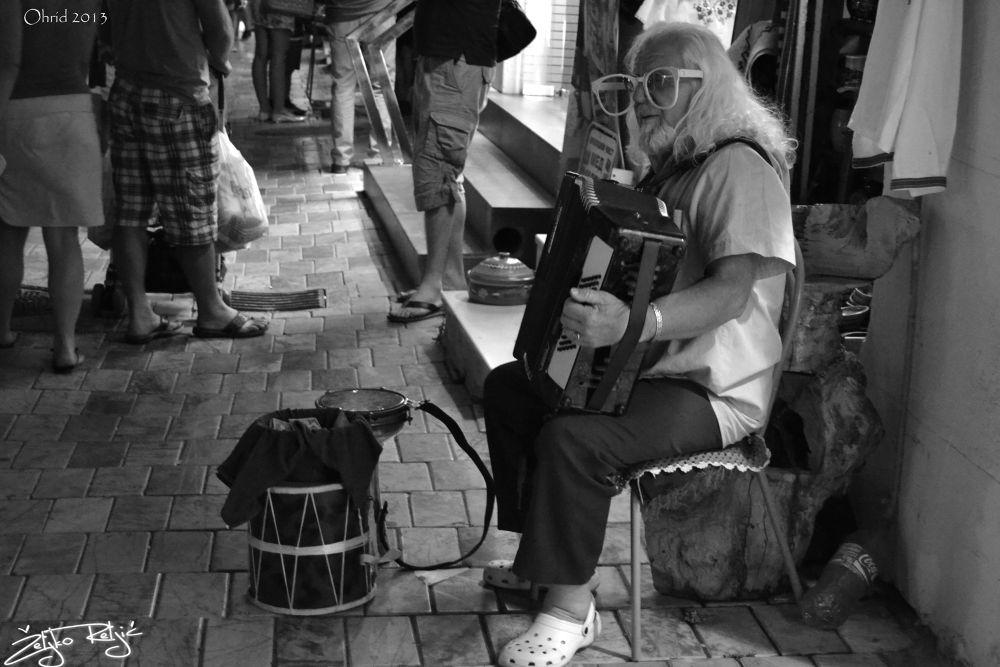 Street musician  by zeljkoreljic