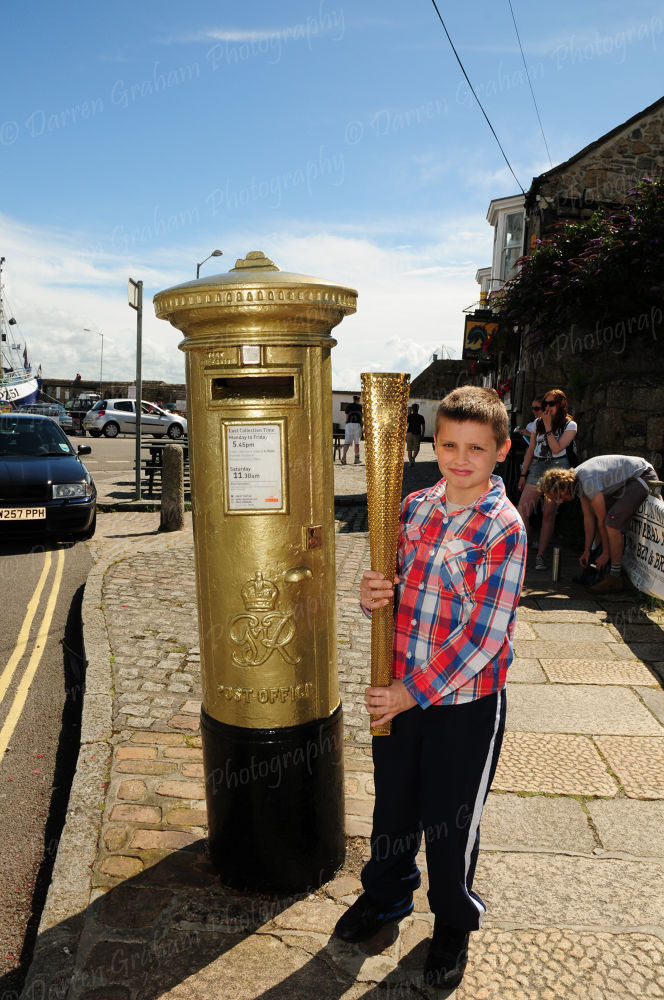 Penzance got the first gold post box and my son with olympic torch by DarrenGrahamPhotography