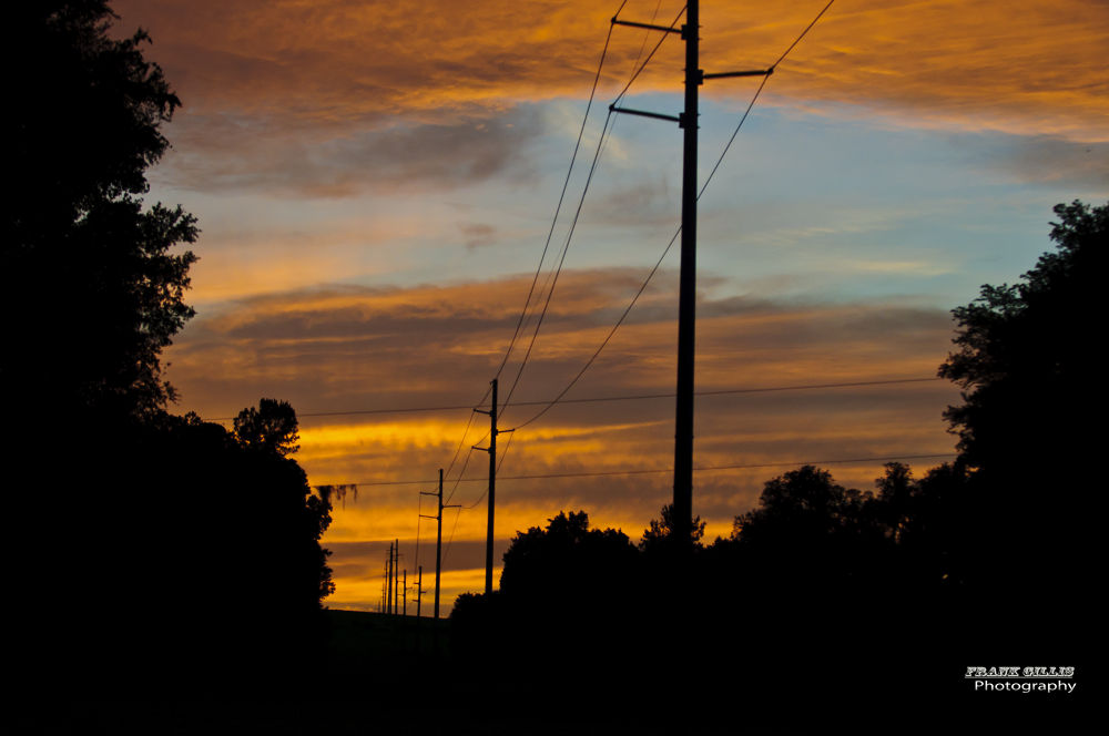 Sunset over power lines. by banditrx
