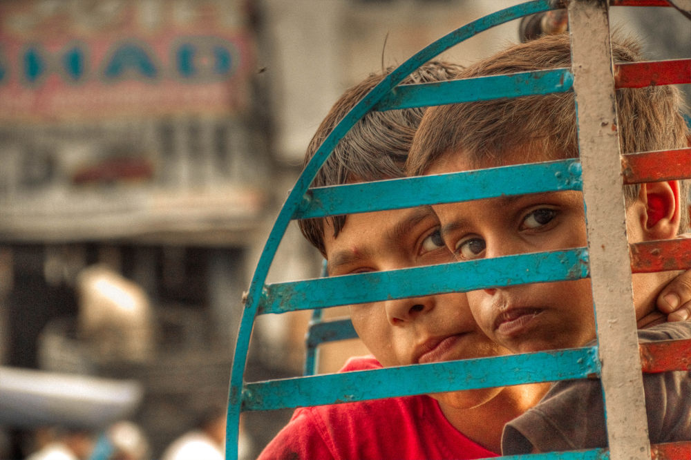i see fire in there eyes..shots at streets of Delhi slums by aswinsphotography