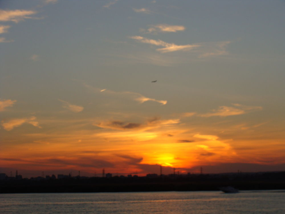 Setting Sun spraying gold! On a cloudy October 2012 in New Jersey, USA!! Photo by me. by raghavankk
