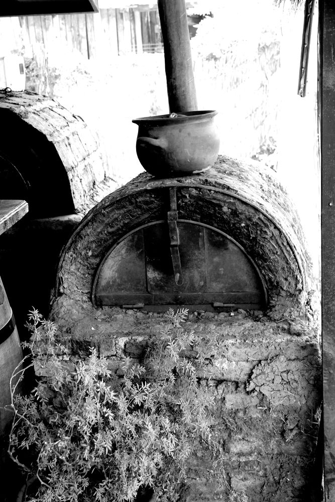an adobe oven. the bread will be ready in about 5 minutes by ichernin