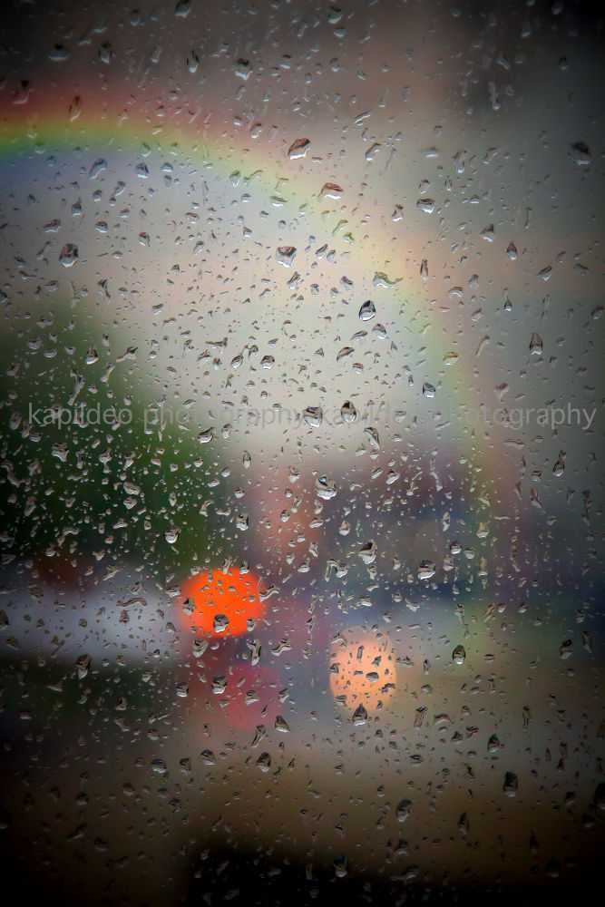 There is no rainbow without a little rain!  by hereapurva