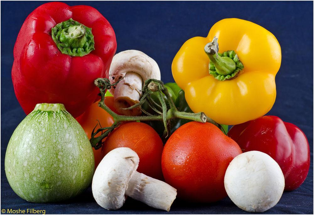 Making a fresh vegetable salad by Moshe Filberg