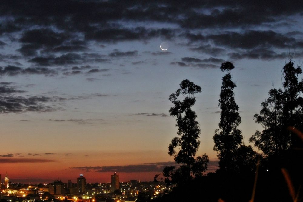 Crescent Moon over Trees and City by Odilon Simões Corrêa