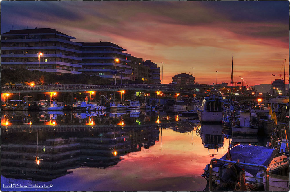 Reflections in the sunset by Ivano D'Ortenzio