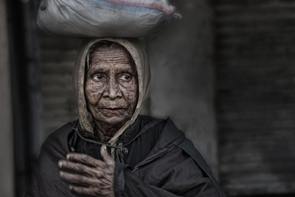 an old bengali woman by Somyot & Majid S Blend Werk