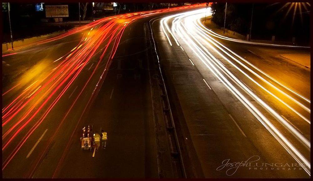 Photo in Street Photography #street #lights #traffic #light streaks #light paterns #cars #men at work #fast lanes #speed