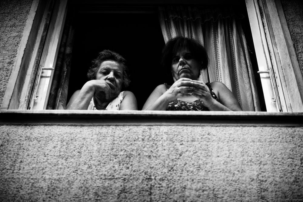 2 ladies at the window by Spyros Papaspyropoulos