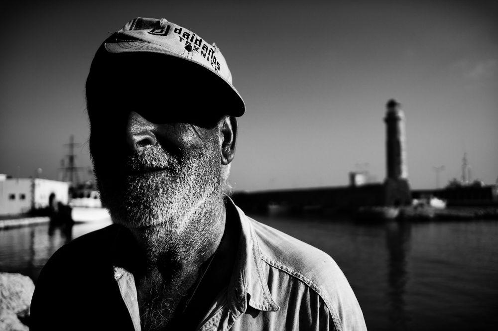 Photo in Street Photography #mono #monochrome #b&w #b&w photography #day shot #day #morning #portrait #portraiture #street #street photography #street portrait #candid #candid photography #candid portrait #lighthouse #rethymno #crete #greece #20mm #sel20f28 #sony nex #nex-6