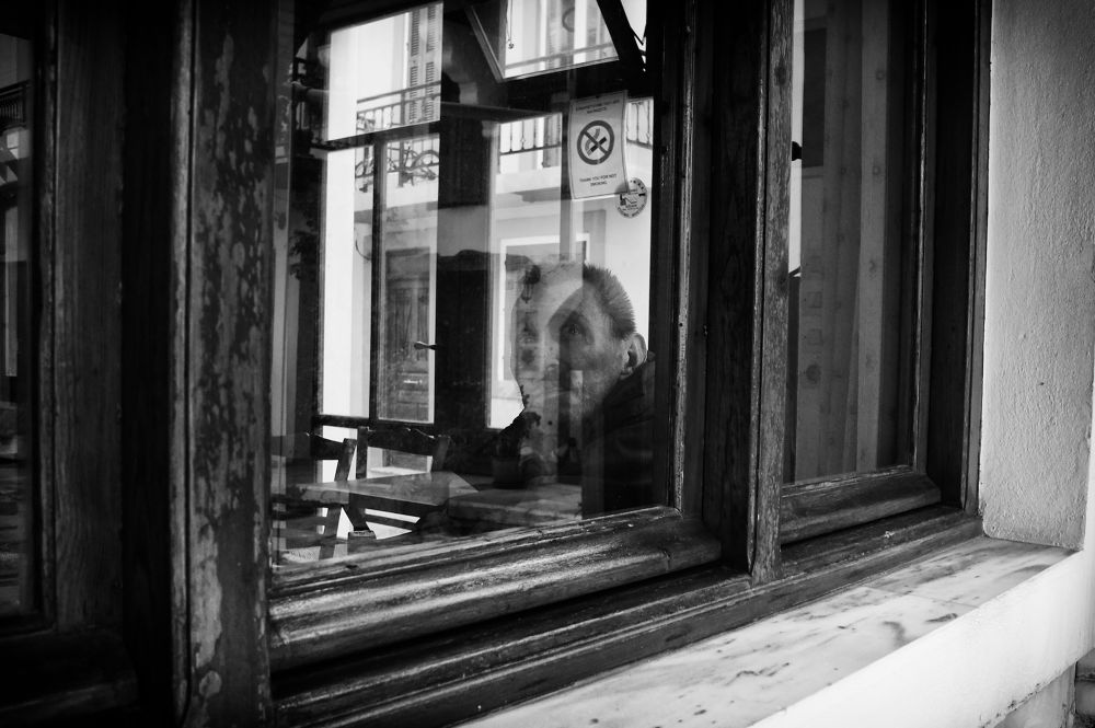Through the coffee shop window by Spyros Papaspyropoulos