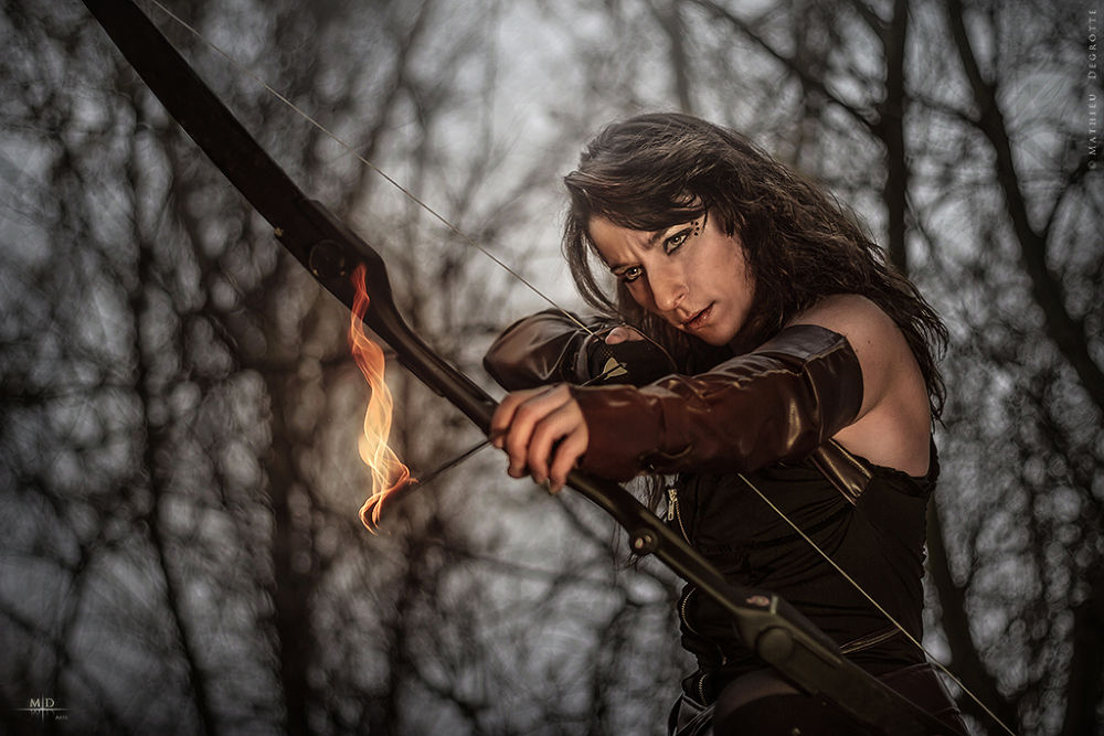 Photo in Fine Art #girl #woman #hunt #hunger #games #hunting #bow #arrow #elf #elve #movie #cosplay #hunger games #anger #flame #flames #fire #hot #sexy #forest #dark #woods #grim #hunter #gloves #fantasy #trailer #epic #branches #tree #night
