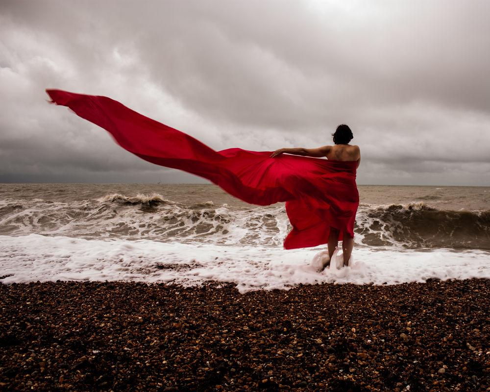 Photo in Fine Art #silk #fine art #brighton #englnd #red #woman #beach #ocean #sea #waves #storm