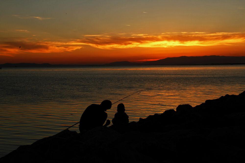 Photo in Random #ypa2013 #sky #sunset #sun #güneş #silhouette #fish #fisher #father #child #son