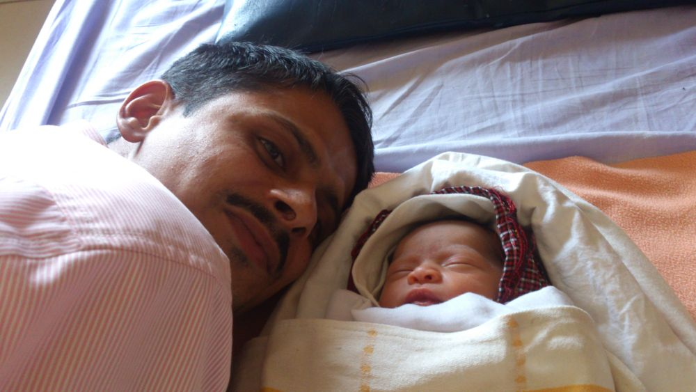 New Born Baby and Father by Nagendra Bhat