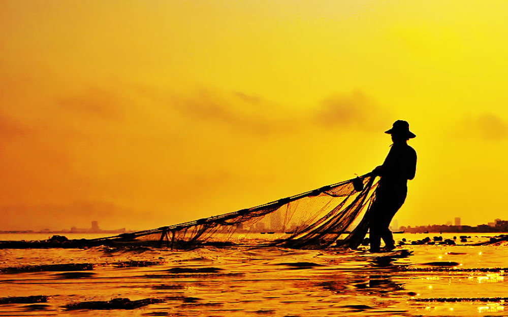 pulling fish net by Boones Nguyen