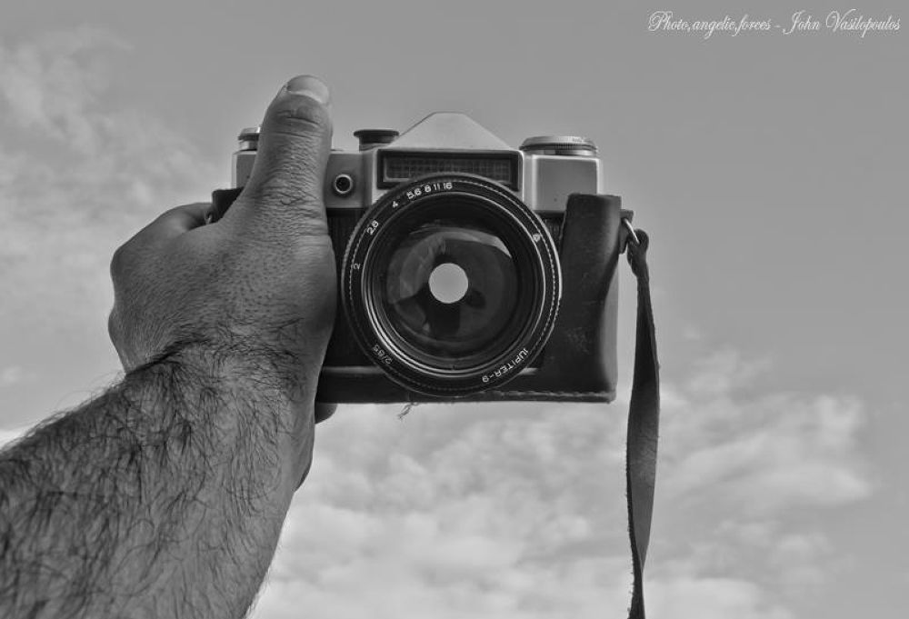 Life is the hand, the camera is the moment of our life by S,J,V John Vasilopoulos