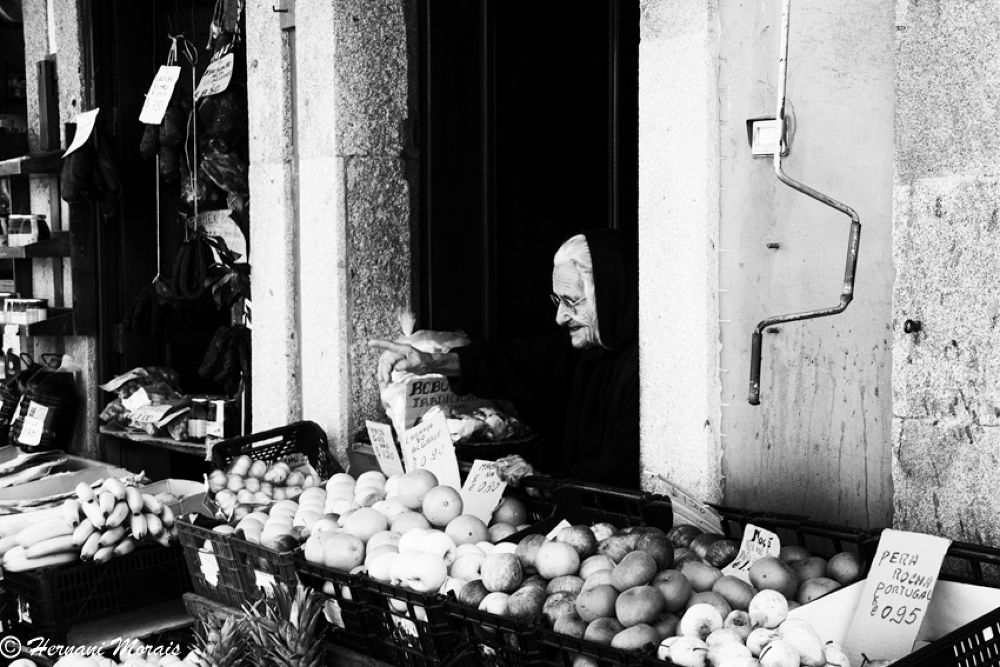 Woman at the grocery store door by hernanimorais5