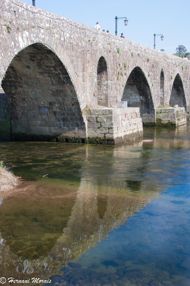 Reflections of the Roman bridge by hernanimorais5
