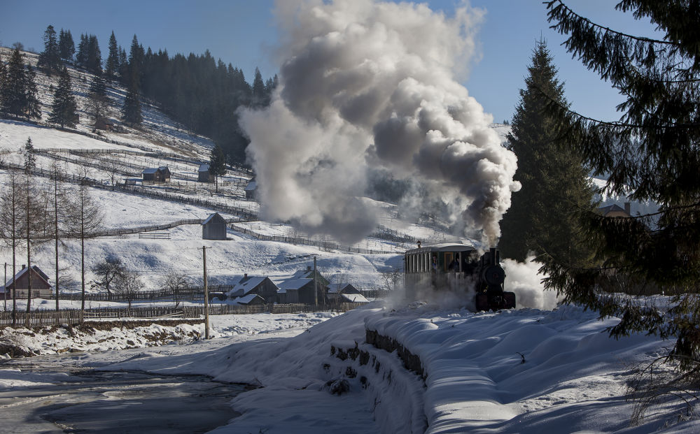 Touristic route with the steam train in Bukovina, Romania, december 2012 by bogdancomanescu