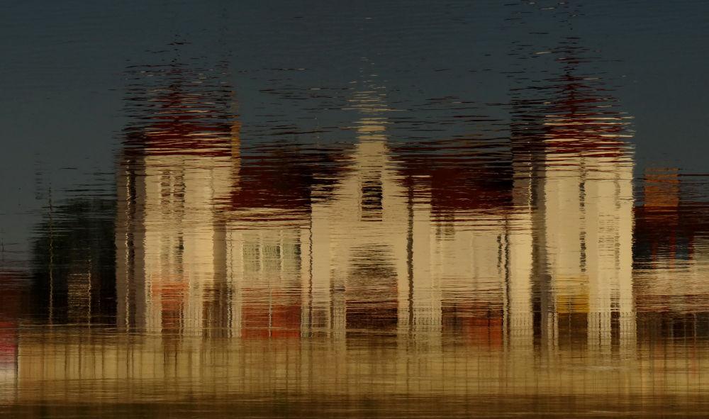 Reflection in the river Sava by Alekdandar Dekanski