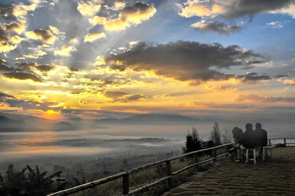 Early morning mist while sunrise at Doi Yun Lai in the Santichon village, Mae Hong Son province in T by Kittirit