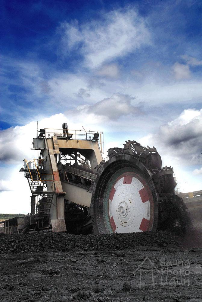 coal scraper machine, Tanjung Enim, Padang, Indonesia. by gun art photoshoot