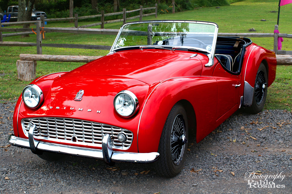 Photo in Random #triumph #red #convertible #rag top #drop top #roadster #classic #antique #vintage