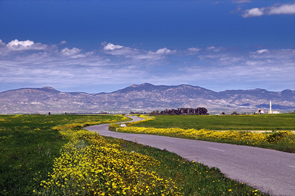 Photo in Landscape #trip #road #minaret #mountains #sky #clouds #blue #green #yellow #trees