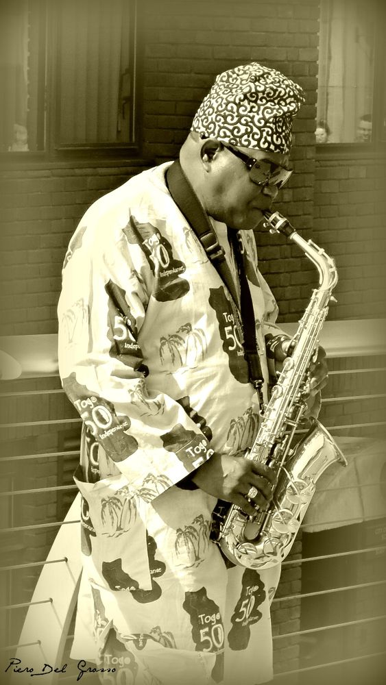 Saxophonist on the Millennium Bridge - London by Piero Del Grosso