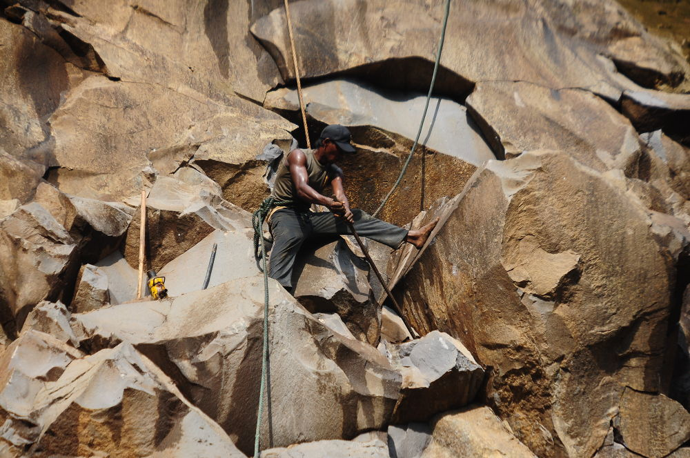 mountain stone quarry workers with high risk by REOG BIYAN