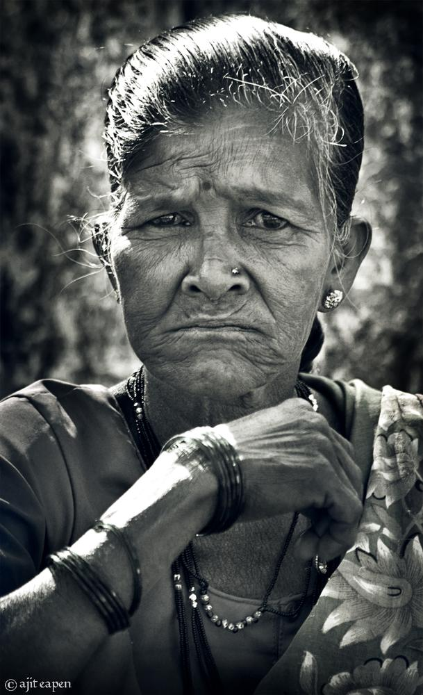 Photo in Portrait #warli tribe-woman #warli #tribe #woman #ethnic #indigenous #mumbai #vasai #india #asia #forest #people #ajit eapen #fine art #art #face #black and white #angry #stare #lady #old