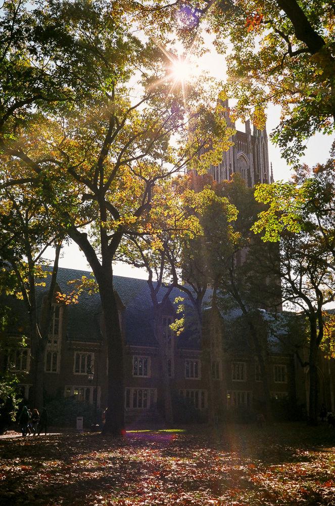 Photo in Random #fall #autumn #school #college #foliage #lens flare #ultramax 400 #canonet #ql17 #35mm film #wellesley college #new england #green hall #stone tower #sun