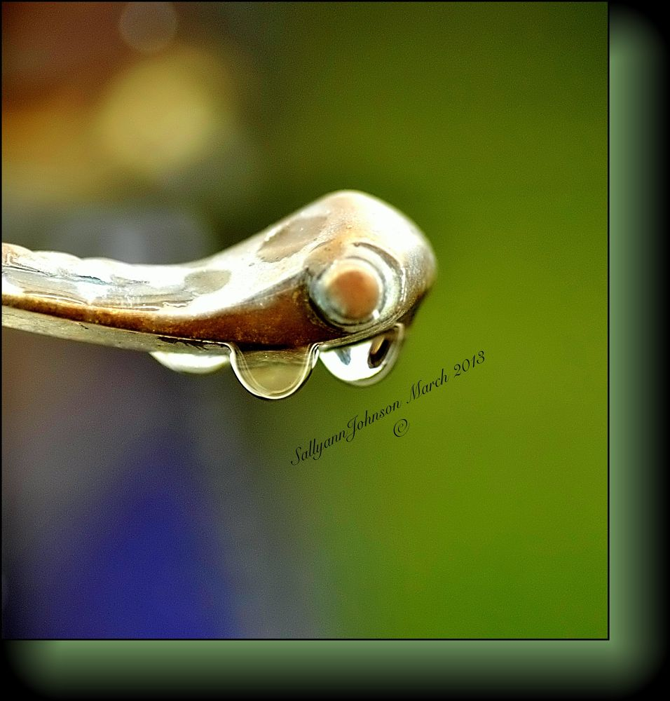 Water droplets on a door handle by sallyjohnson31586526